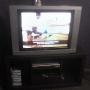 vendo tv tcl 34 tiene 2 años  + rack color chocolate buena imagen