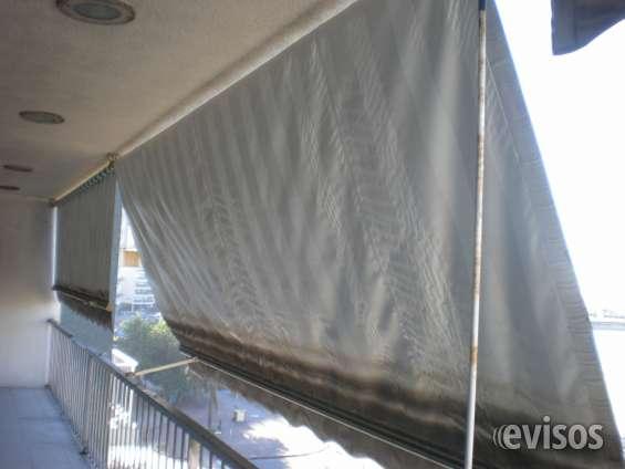 Terraza de 14 m de largo con toldo