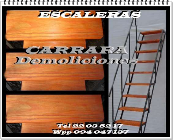Escalera tel: 22035217  con escalones de madera y estructura de metal carrara demoliciones